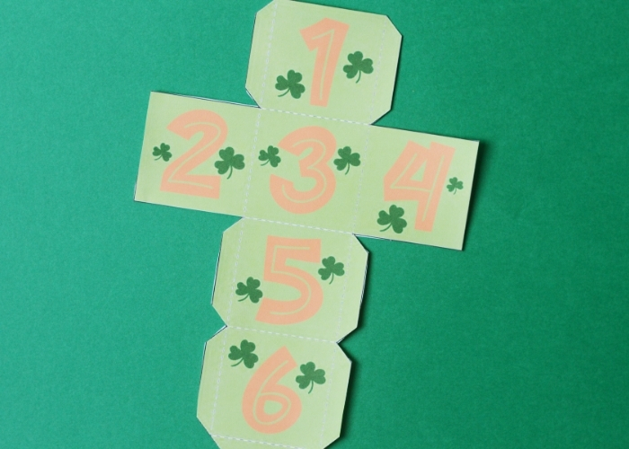The printed and cut out dice for the St Patrick's Day board game.