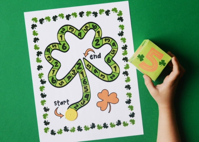 A child playing the free printable St Patrick's Day math activity.