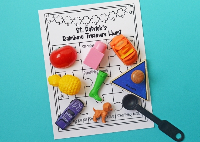 The St. Patrick's Day Rainbow Color Scavenger Hunt worksheet with colorful toys on it.