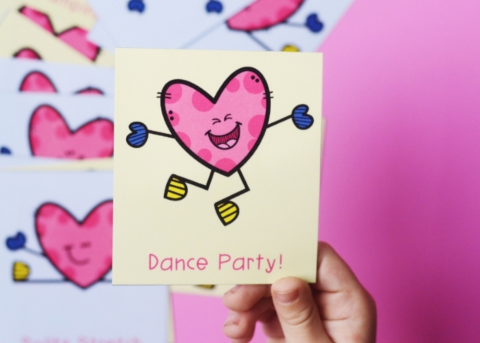 """A printable for Valentine's Theme Gross Motor Exercises that says, """"Dance party!"""""""