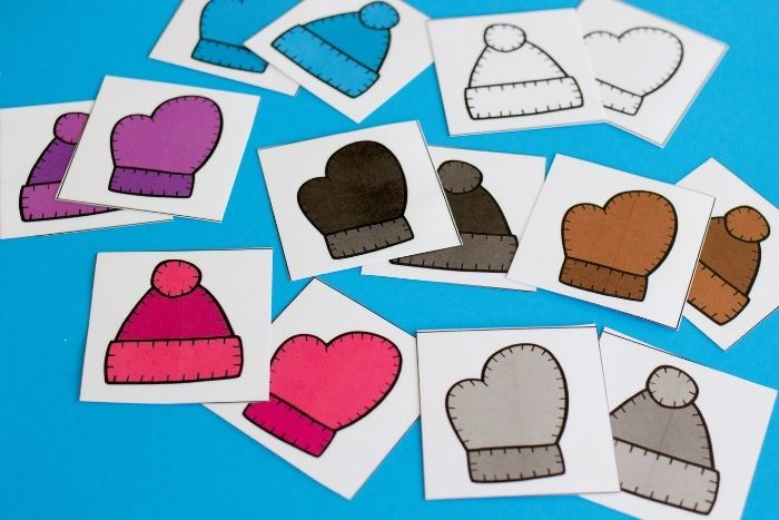 Overhead view of the hats and mittens winter colors matching game.