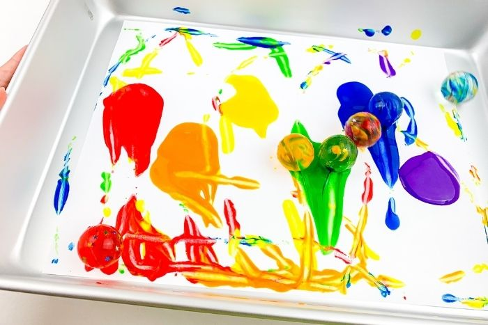 Close up of the colors being mixed during the rainbow bouncy ball process art.