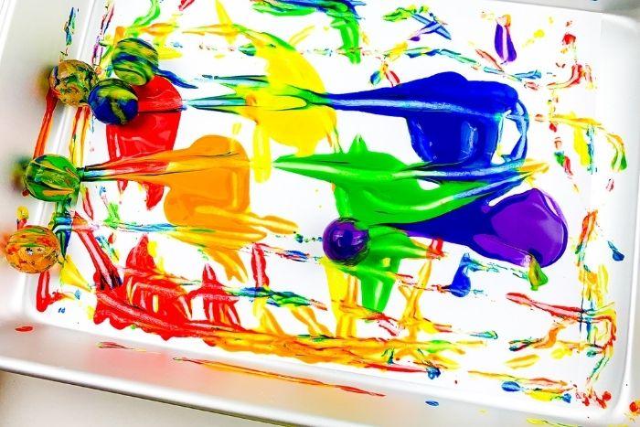 Close up of the rainbow bouncy ball process art activity.