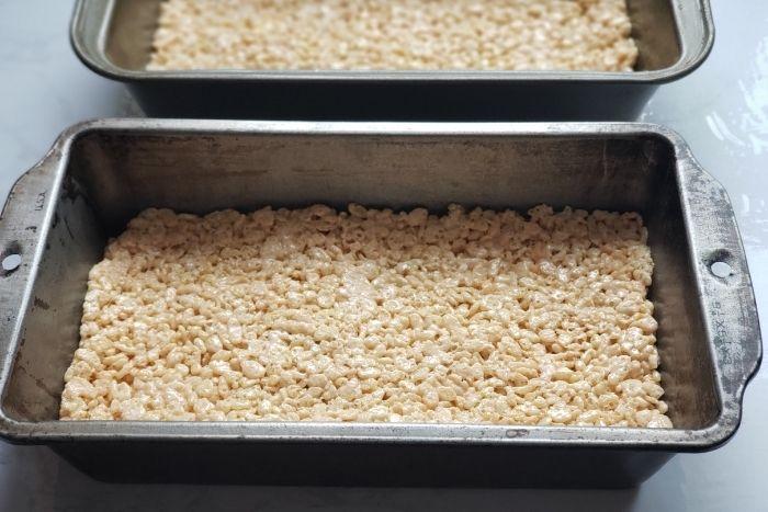 Homemade rice krispy treats in a metal baking pan.