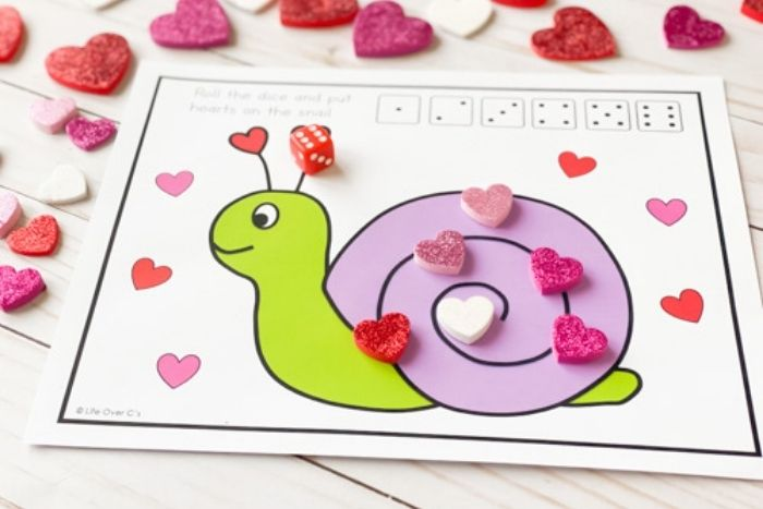 The Valentine's Day Roll and Count game with 3 hearts on it.