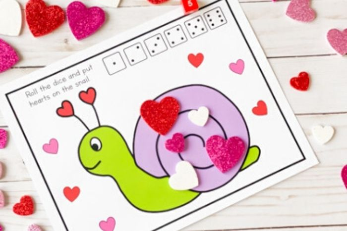 The Valentine Math Play Dough Counting Game with 5 hearts on it.