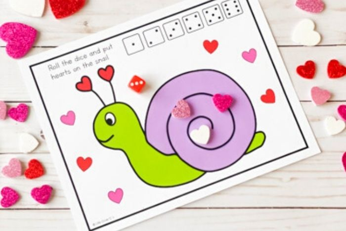 The Valentine Math Play Dough Counting Game with 3 hearts on it.