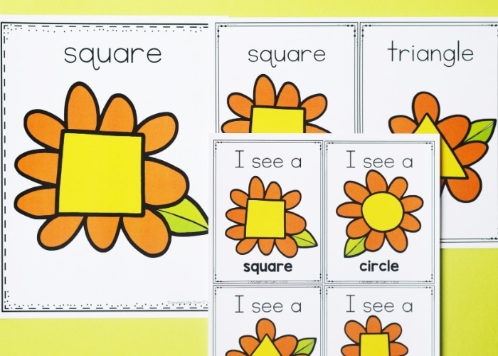 Overhead view of the spring theme posters shape activities printables.