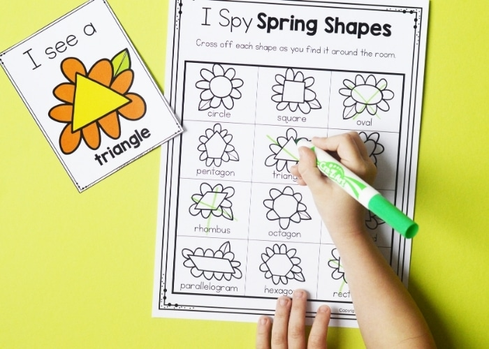 """A child completing the """"I Spy Spring Shapes"""" free printable worksheet."""