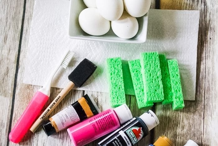 Close up of the supplies for the galaxy easter egg decorating for kids.