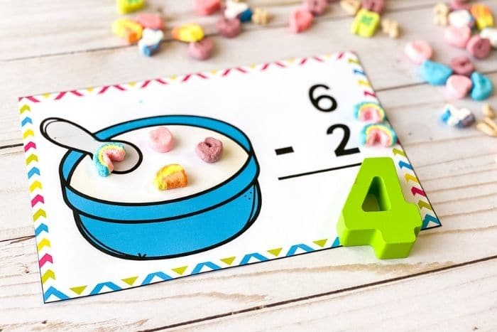 "The free marshmallow subtraction math mat for the number ""4""."