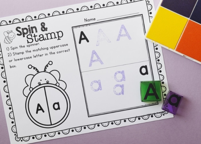 Overhead view of the Bee Theme Spin and Stamp Preschool Alphabet Worksheet for the letter