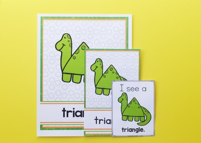 Close up of the cutout triangle dinosaur shape posters.
