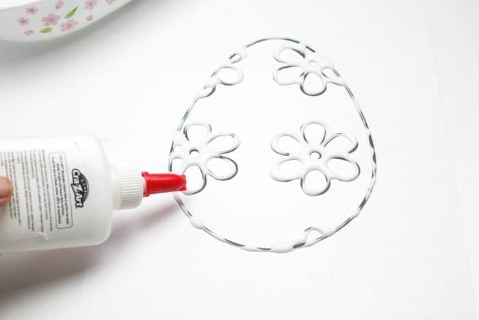 Easter egg salt painting for kids tracing Easter egg printable with glue