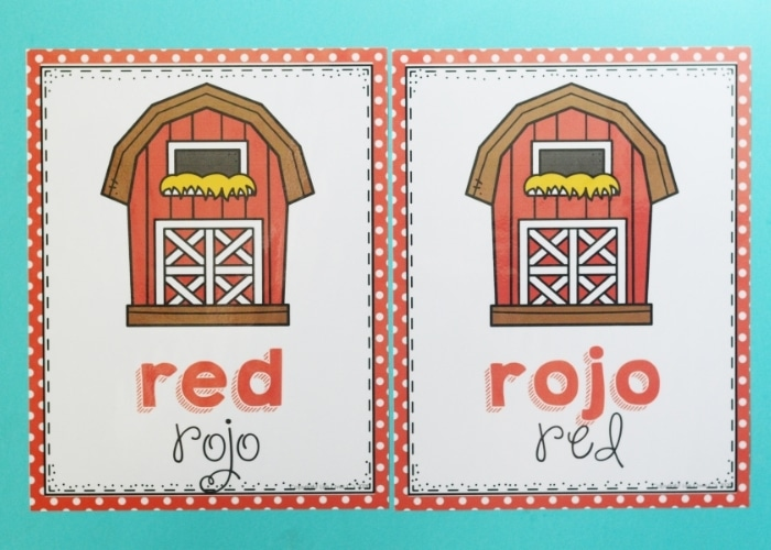 A farm theme color poster of a barn for the color red in both English and Spanish.