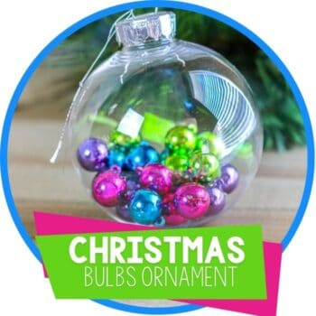 Christ clear ornament filled with pink, blue, green and purple miniatured Christmas bulbs Featured Image