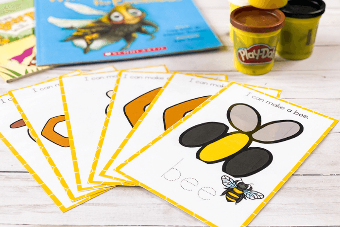 Free printable life cycle of a bee preschool play dough mats. Bee play dough mat shown with jars of play doh.