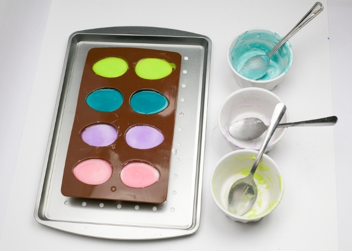 An Easter egg mold filled with colored baking soda and water.