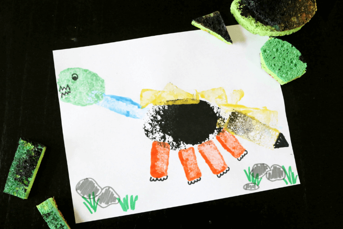 Overhead view of the sponge painted dinosaur activity.
