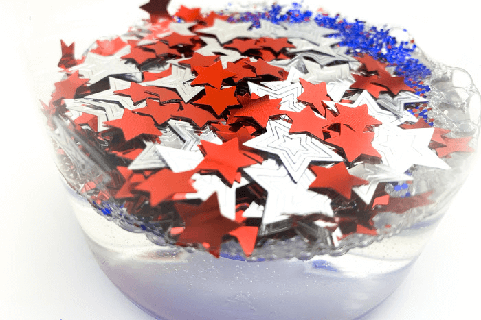 Patriotic confetti added to a jar of glue for the DIY patriotic calm down jar.