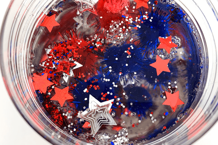 Overhead view of the glue and patriotic confetti mixed together.