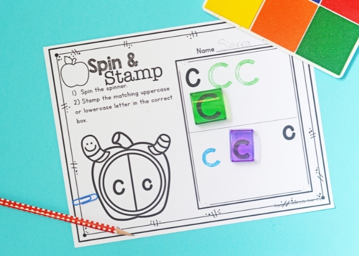 Overhead view of the Apple Theme Alphabet Stamp Activities for Preschool worksheet for the letter