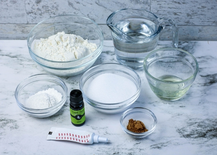 The ingredients for the Easy No-Cook Apple Cinnamon Play Dough Recipe.