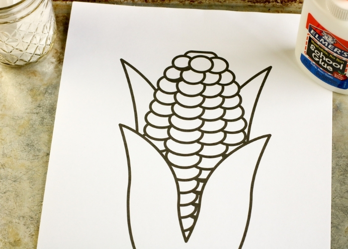 Overhead view of the supplies for the Fall Theme Calico Corn Salt Painting for Kids.