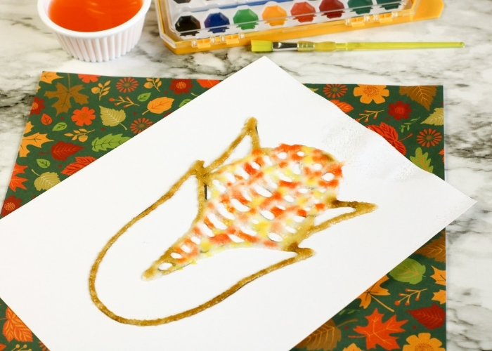 The painted Fall Theme Calico Corn Salt Painting for Kids.