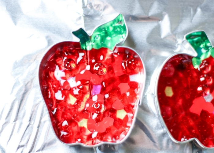 Beads melted for the Melted Bead Suncatchers Apple Crafts for Kids.