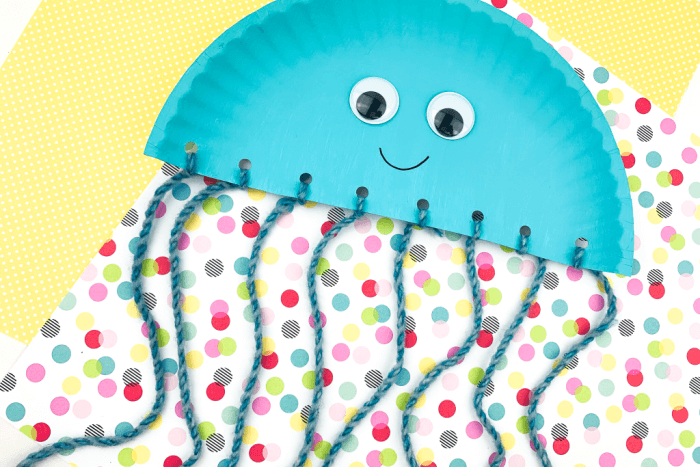 The finished Easy Paper Plate Octopus Craft for Kids on a polka dot background.