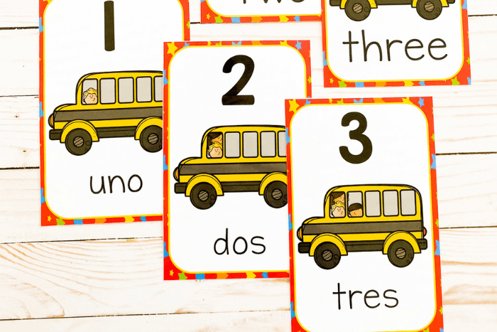 The school bus themed number posters for the numbers 1-3 in both English and Spanish